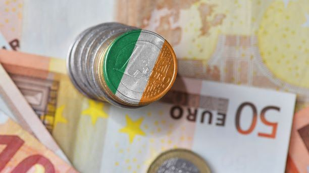 euro coin with national flag of ireland on the euro money banknotes background