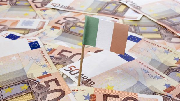 Irish Flag on pole stuck into 50 euro notes