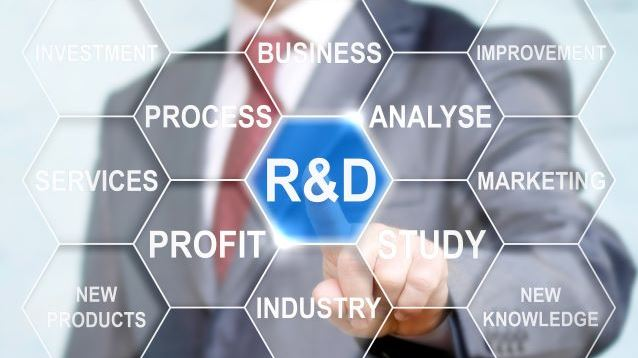 Businessman touched r and d sign